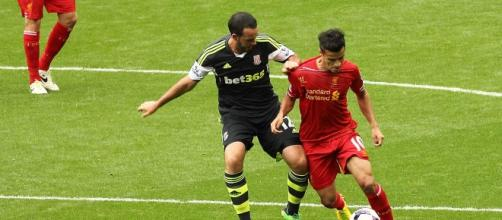 Wilson et Coutinho - Real - CC BY