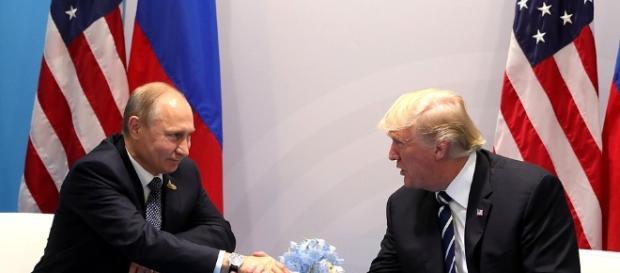 Donald Trump and Vladimir Putin shake hands at the G20 summit in Hamburg, Germany (Source: Kremlin)