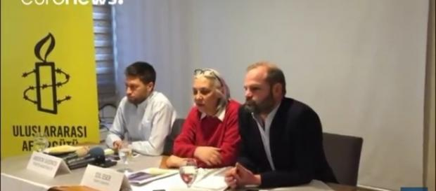 Members of Amnesty International Turkey. / [Image screenshot from Euronews via YouTube:https://youtu.be/T26Q_As7rYM]