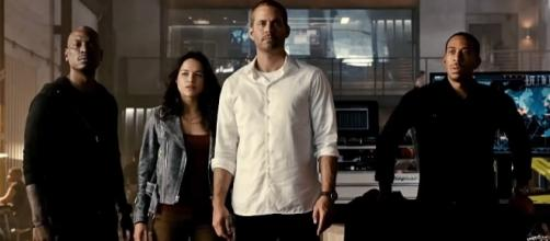 "Photo Paul Walker and the cast of ""Furious 7"" screen capture from YouTube video/Wiz Khalifa"