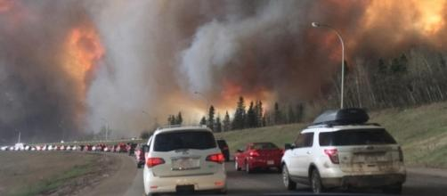 Photo shows the 2016 Fort McMurray Wildfire, mentioned in the article ( Wikipedia - wikipedia.org)