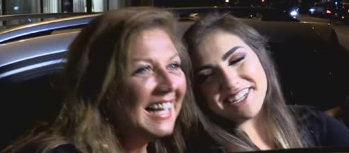 Abby Lee Miller headed in to prison to start her 366-day sentence. Image via YouTube/Enews