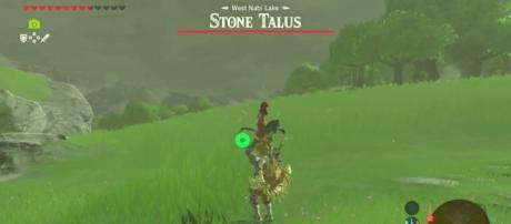 """Using a Cucco as a weapon in """"Breath of the Wild"""" (image source: YouTube/QP GAMES)"""