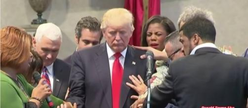 Christians praying over Donald Trump. Photo via Susan Jenkins, YouTube.