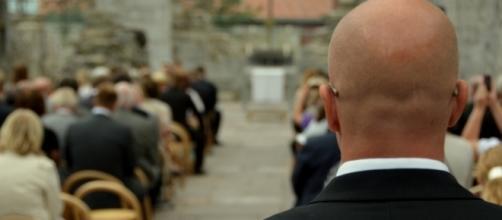 Secret Service Agent standing guard. / [Image by John Christian Fjellestad via Flickr, CC BY 2.0]
