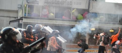 Tear gas used on student protesters in Altamira, Caracas. Source: Andrés E. Azpúrua via Wikimedia Commons