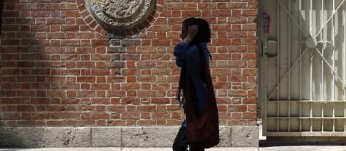 Young Woman Strolls Past Facade of Old US Embassy (US Den of Espionage) - Tehran - Iran. Adam Jones via Wikimedia Commons.
