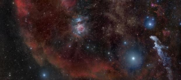 Orion constellation showing the surrounding nebulas of the Orion Molecular Cloud complex by Rogelio Bernal Andreo via Wikimedia Commons