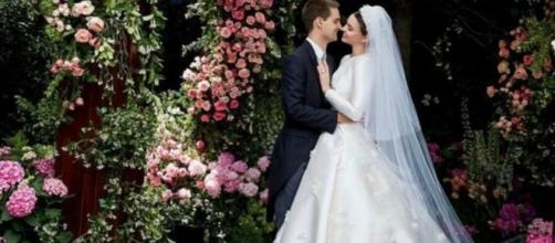 Miranda Kerr wears a Grace Kelly-inspired gown during her altar date with Evan Spiegel (Instagram)