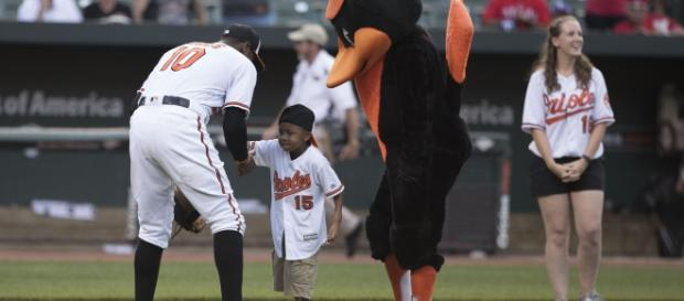 Zion Harvey throwing out the ceremonial first pitch.