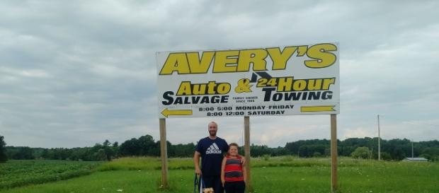 Supporters in front Of Avery Auto Salvage sign/photo credit Dana L Weinert/Facebook
