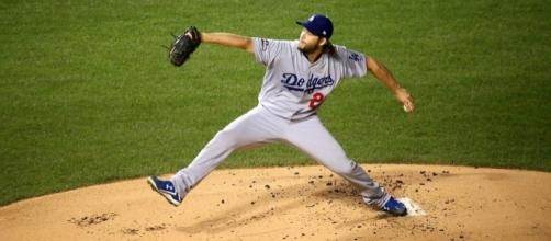 Dodgers starter Clayton Kershaw delivers a pitch during NLCS Game 6 by Arturo Pardavila III from Hoboken, NJ, USA via Wikimedia Commons