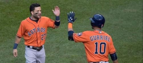 Altuve (27) with Gurriel, Flickr, Keith Allison CC BY-SA 2.0 https://www.flickr.com/photos/keithallison/28524696333