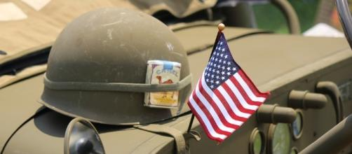Symbol of America as a world power. https://pixabay.com/en/helmet-flag-patriotism-1475770/