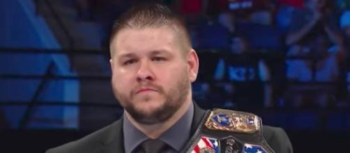 United States Champion Kevin Owens was forced to defend his title in a triple threat on Tuesday's 'SmackDown Live.' [Image via WWE/YouTube]