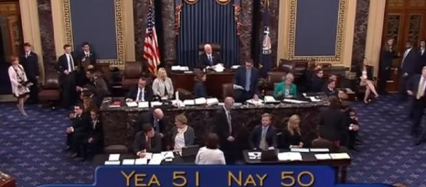 US Senate voting 51-50 in favor of the motion proceed with debate- (YouTube/Time)