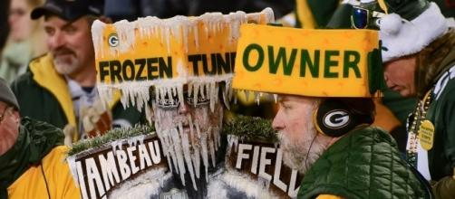 Most passionate Packers fans like these dress up in Cheesehead due to Wisconsin's food products (Via Flickr Mike Morbeck)