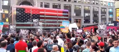 Protesters flood Times Square in demo against Trump's transgender service ban- Image - RT UK | YouTube