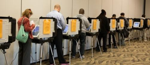 Voting in Maryland, 2014. / [Image by Maryland Govpics via Flickr, CC BY 2.0]