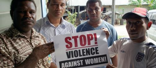 Live and Learn staff pose with a 'Stop! Violence against women' sign - Image Department of Foreign Affairs and Trade   CC BY 2.0   Flickr