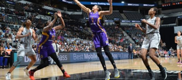 Candace Parker, second from right, goes for the rebound. Picture courtesy of ESPN.com