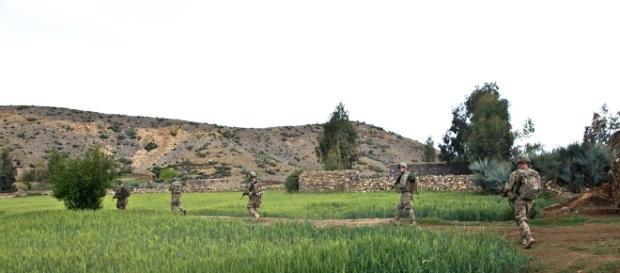 US troops survey the countryside in Afghanistan.https://pixabay.com/en/troopers-troops-soldiers-fields-60770/