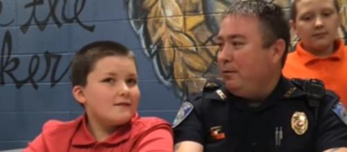 Jody Thompson with his adopted son John - YouTube/ABC News