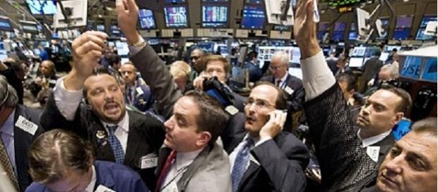 New York Stock Exchange trading floor credits:flickr https://www.flickr.com/photos/83532250@N06/7651028854