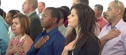 About 15,000 people were sworn in to become U.S. citizens [Image: Stomedy/YouTube screen shot]]