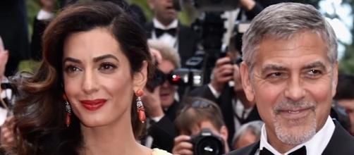 George and Amal Clooney took their newborn twins to Milan. (Entertainment Tonight/YouTube)