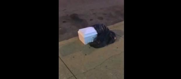 Photo casket found on Philadelphia street screen capture from YouTube/Skorch Flamez