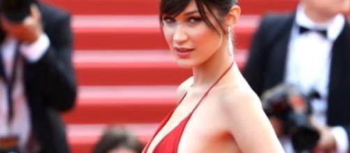 Fashion icon Bella Hadid stuns crowd on her see-through black top in Paris. Image via YouTube/BBC News