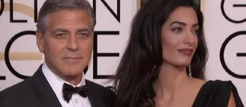 George and Amal Clooney took twins to Milan, Italy. Image via YouTube/ET