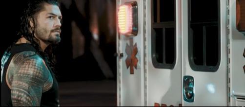 Roman Reigns battles Braun Strowman in an Ambulance Match at Sunday's WWE PPV. [Image via WWE/YouTube]