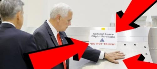 Mike Pence at NASA is doing what the 'Do not touch' sign says not to! Image credit: YouTube screencap Via Tech Tube