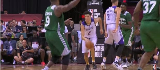 Lonzo Ball dribbles the ball against the Boston Celtics. Photo -- YouTube Screenshot/@NBA