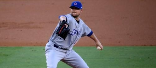 Cubs starter Jon Lester delivers a pitch during the first inning of #NLCS Game 5 by author	Arturo Pardavila III via Wikimedia Commons