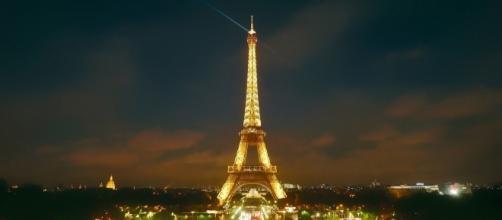 Eiffel Tower illuminating the night sky in Paris, France. - tpsdave via pixabay