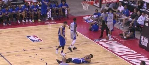 Sixers rookie Markelle Fultz stays on the court following a bad landing in the third quarter. [Image via NBA/YouTube]