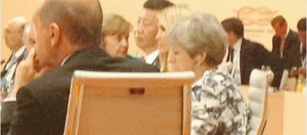 Ivanka is seated between Xi Jinping and Theresa May at G20 meeting. Photo via Svetlana Lukash, Twitter.