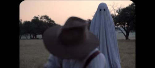 """""""A Ghost Story,"""" is a haunting tale of one's life after death. [Image via YouTube/A24]"""