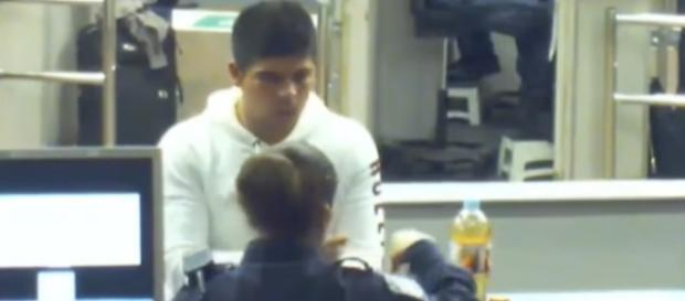 A still showing Cruz Velazquez Acevedo talking with one of the officers who asked him to drink from the bottle. - YouTube/IRATE Productions