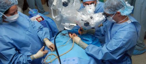 Ear surgery on a patient via John Asselin