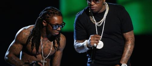 Lil Wayne with Birdman. Image via Flickr by Soletron.