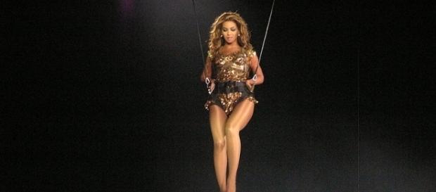 Beyonce during a performance / Photo via Jingjing Cheng, Wikimedia Commons