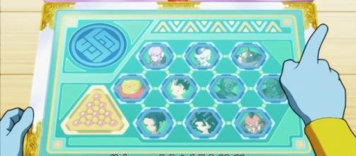 Uno de los dos Zeno Sama revisa su Pad y se revela a los namekuseijin del universo 6: Saoneru y Pirina