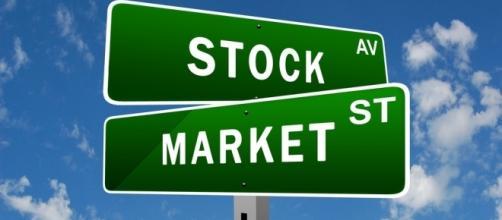 Start investing in stocks right now. [Image via Flickr/Stock Market]