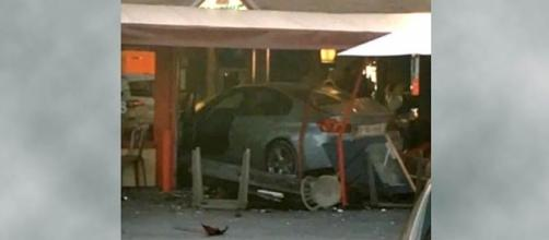 A driver crashed his BMW into a pizzeria in France killing one and injuring 13 [Image: YouTube/ Right Side Broadcasting Network]