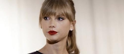 Taylor Swift wins case against DJ David Mueller [Image: CNN Money/YouTube screenshot]