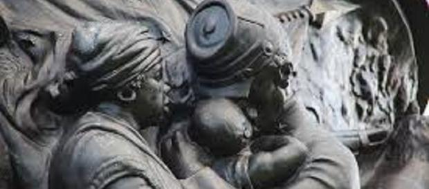 Confederate monument/https://commons.wikimedia.org/wiki/File:Confederate_Monument_-_NE_frieze_mammy_-_Arlington_National_Cemetery_-_2011.JPG